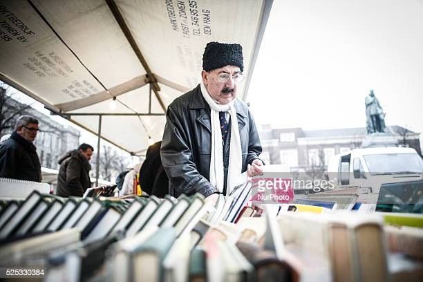A man in a cossack hat is seen browsing books at a second hand market in the centre of Dutch political capital on Thursday Consumer confidence saw a...