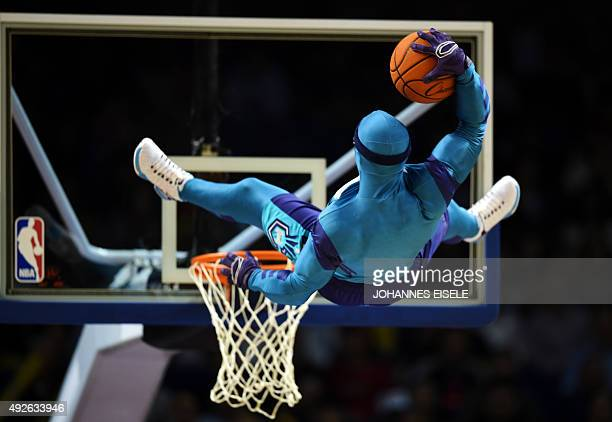 Man in a costume makes a stunt with a basketball before the 2015 NBA Global Games China pre-season basketball match, the Los Angeles Clippers vs...