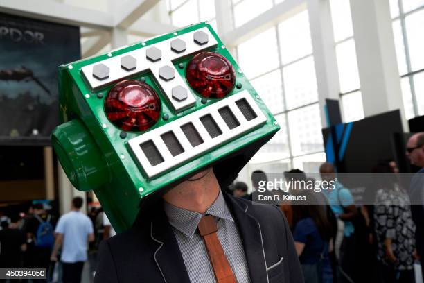 A man in a Destructoid costume at E3 Electronic Entertainment Expo June 10 2014 in Los Angeles California The annual video game conference and show...