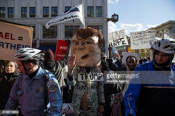 A man in a Donald Trump costume protests outside of the Verizon Center where Donald Trump and other Republican Presidential candidates are speaking...