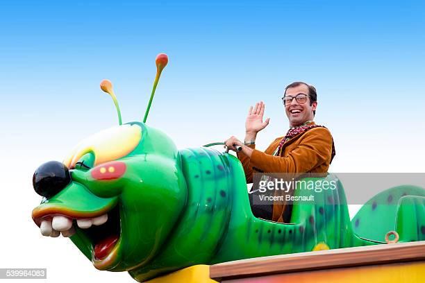Man in a fairground carousel