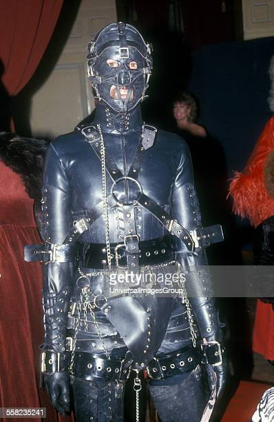 A man in a Gimp fetish suit Skin Two Club UK 1980s