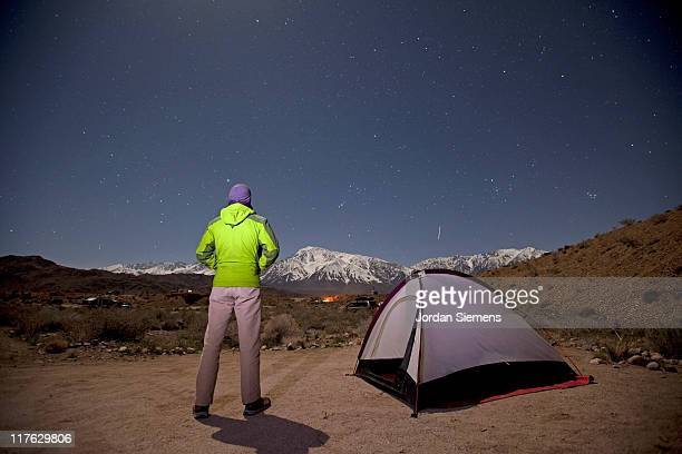 man in a green jacket star gazing. - next to stock pictures, royalty-free photos & images