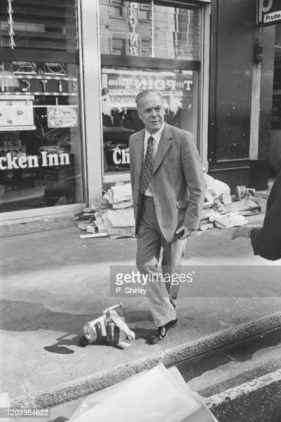 A man in a grey suit walking on Oxford Street after the Provisional IRA had exploded a car bomb on 19 December 1974 outside Selfridge's department...