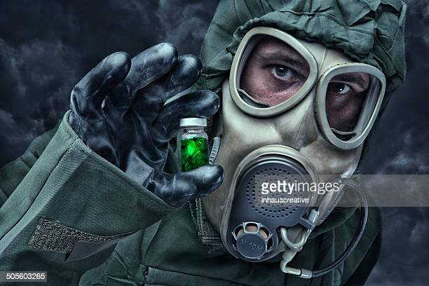 Man in a hazmat Suit holding vial