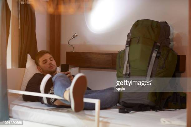 man in a hostel - hostel stock pictures, royalty-free photos & images