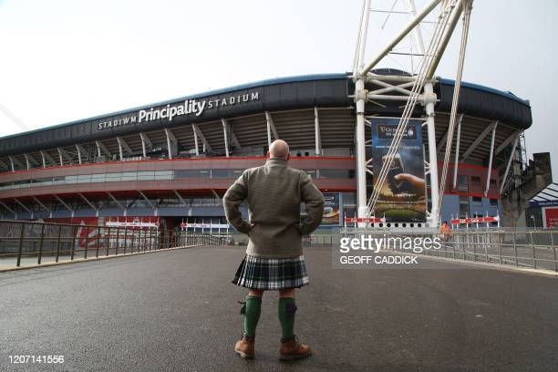 TOPSHOT A man in a kilt stands in front of the Principality Stadium in Cardiff Wales on March 14 2020 This weekend's Six Nations international...