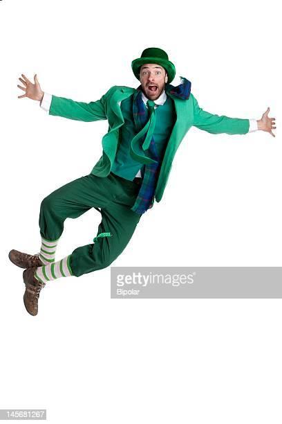 man in a leprechaun costume jumping for joy