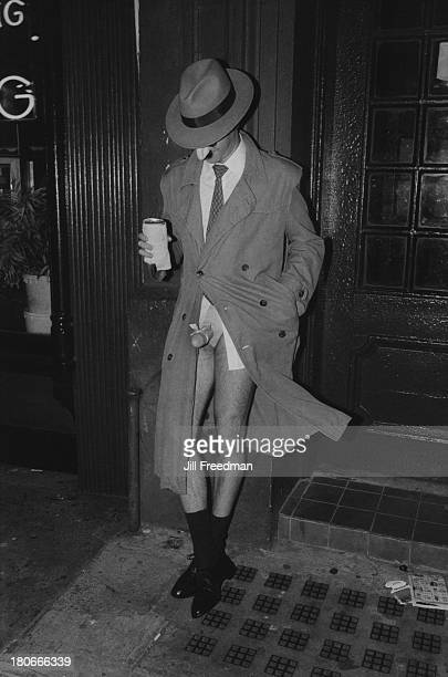 A man in a mask reveals his fake penis on the street in Greenwich Village New York City 1983