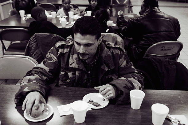 man eating at soup kitchen in new york pictures getty images