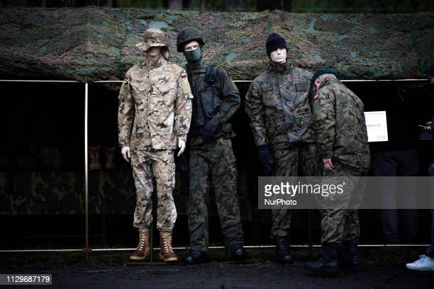 A man in a military uniform is seen inspecting mannequins dressed in different types of camouflage in Bydgoszcz Poland on March 9 2019 The local...