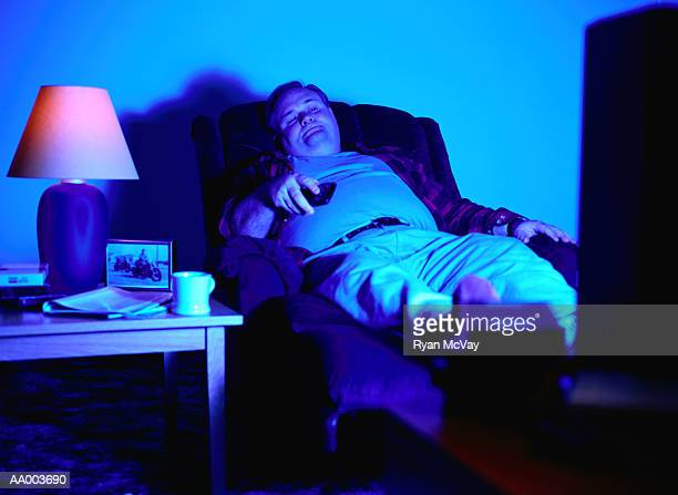 Man in a Recliner Chair Watching Television
