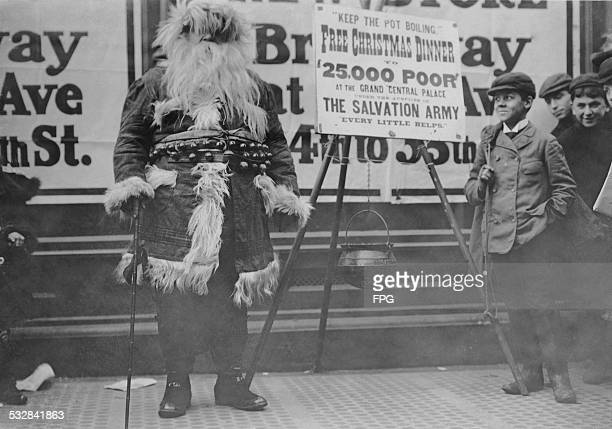 A man in a Santa Claus outfit helping to publicize a free Christmas dinner event organized by the Salvation Army for '25000 poor' at the Grand...