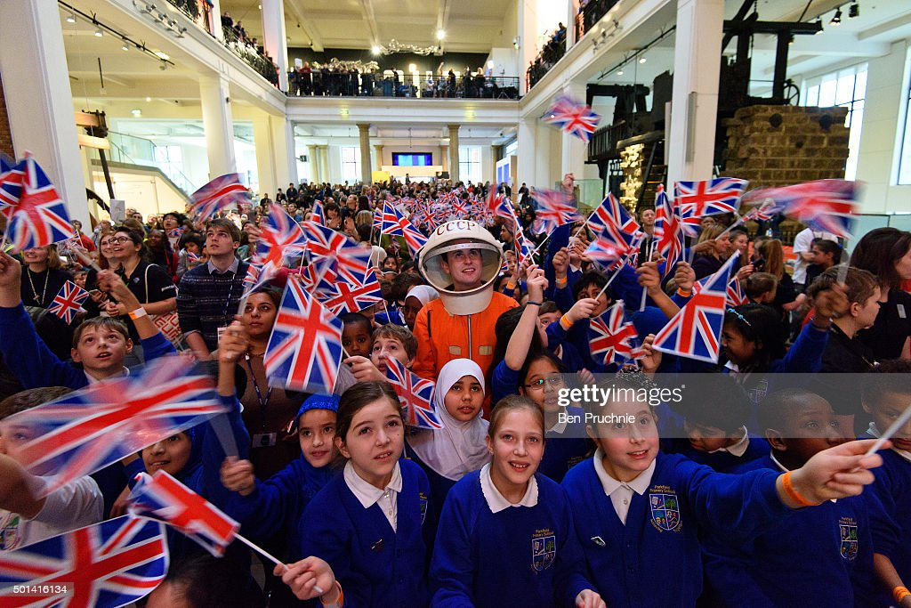 A man in a space suit watches a television with school children at the Science Museum ahead of the launch of space mission Principia from Baikonur Cosmodrome in Kazakhstan on December 15, 2015 in London, United Kingdom. European Space Agency Astronaut Tim Peake is a former British Army Air Corps Officer and is the first publicly funded Briton in Space. He should arrive at the International Space Station (ISS) at 6.30pm GMT and will spend the next six months maintaining the ISS and conducting experiments.