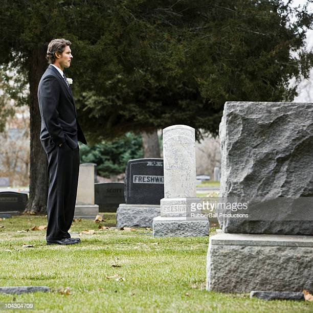 man in a suit at a cemetery - cemetery stock pictures, royalty-free photos & images