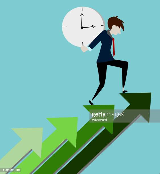 man in a suit carrying a clock - clocks go forward stock pictures, royalty-free photos & images