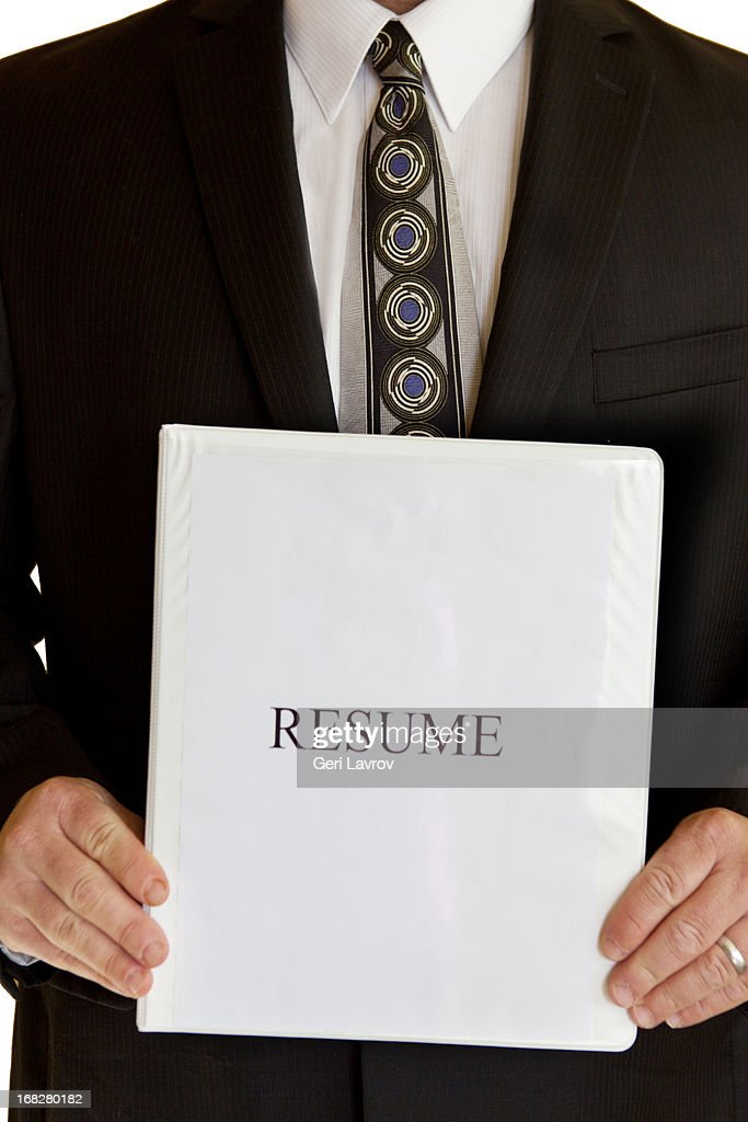 Man In A Suit Holding A Resume Binder : Stock Photo  Resume Binder