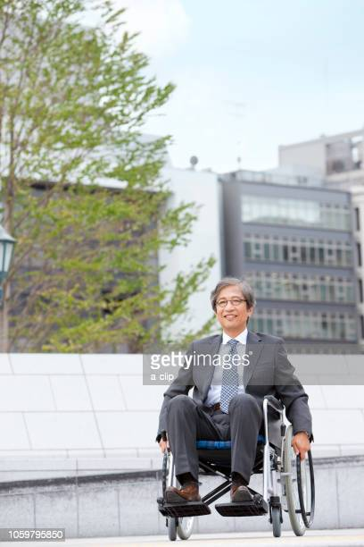 A man in a suit in a wheelchair