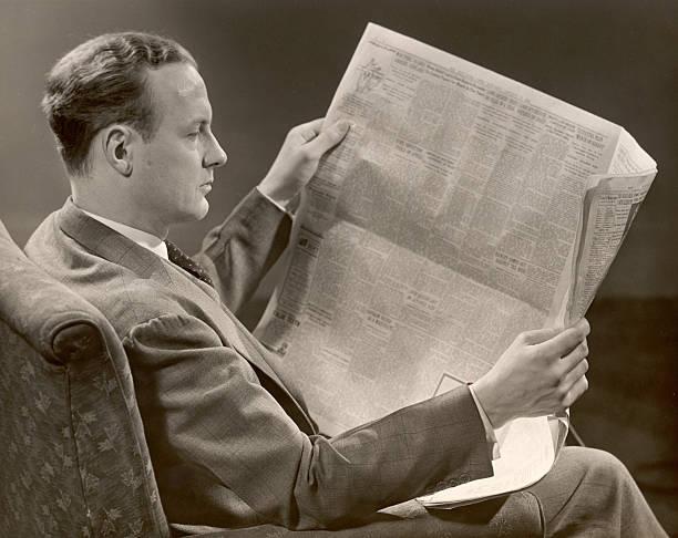 A Man Reads A Newspaper Wall Art