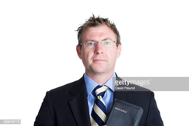 man in a suit with a bible - pastor stock pictures, royalty-free photos & images