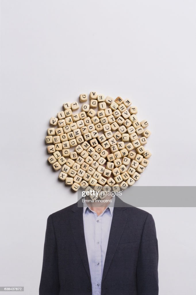Man in a suit with head covered in letters : Stock Photo