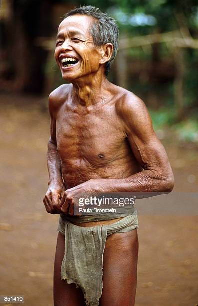 A man in a traditional loincloth laughs at visitors July 1993 He is a member of the Hill tribes in the central highlands of Vietnam