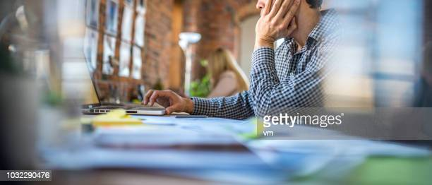 man in a trendy office - differential focus stock pictures, royalty-free photos & images