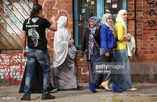 A man in a tshirt with the words 'I heart Palestine' gestures to a group of women supporters as they arrive for the 13th Palestinians in Europe...