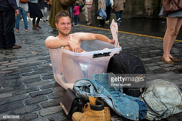 CONTENT] Man in a tub in the middle of the street at Edinburgh Festival Fringe 2013 promoting his show