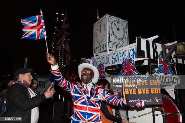 A man in a Union Jack suit and glasses takes part in a rally celebrating Britain's departure from the EU in Parliament Square on 31 January 2020 in...