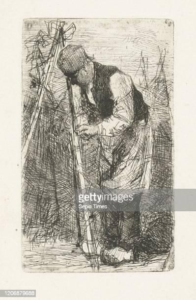 Man in a vegetable garden, Bernardus Johannes Blommers, 1855-1914.