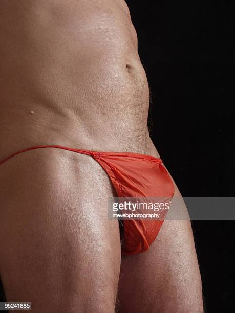 man in  a wet orange thong - stevebphotography stock pictures, royalty-free photos & images
