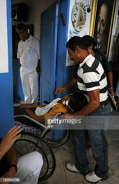 A man in a wheelchair enters Joao de deus office at the 'Casa de Dom Inacio de Loyola' in Abadiania 120km southwest of Brasilia state of Goias on...