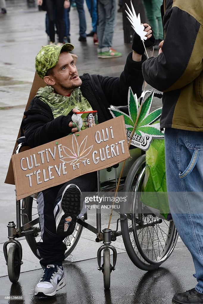 A man in a wheelchair holds a placard reading 'cultivate what gets you high and healed' as he takes part in a protest to call for the legalization of marijuana on May 10, 2014 in Paris. About 147 million people globally -- or about 2.5 percent of the population -- use cannabis, according to the World Health Organization.