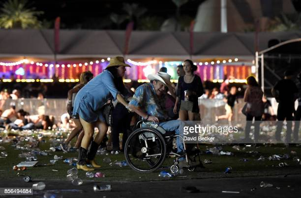 A man in a wheelchair is taken away from the Route 91 Harvest country music festival after apparent gun fire was heard on October 1 2017 in Las Vegas...