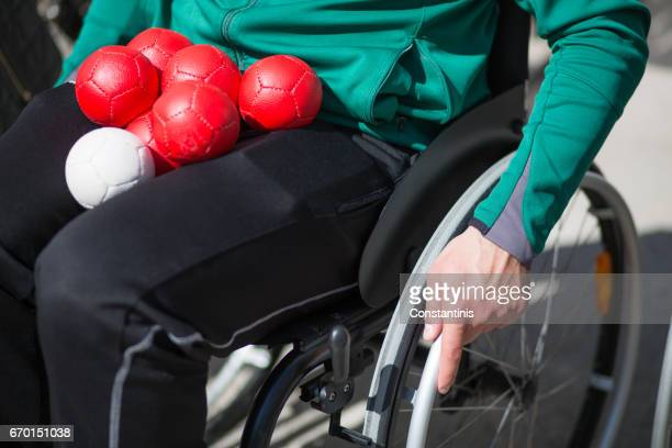 man in a wheelchair - assistive technology stock photos and pictures