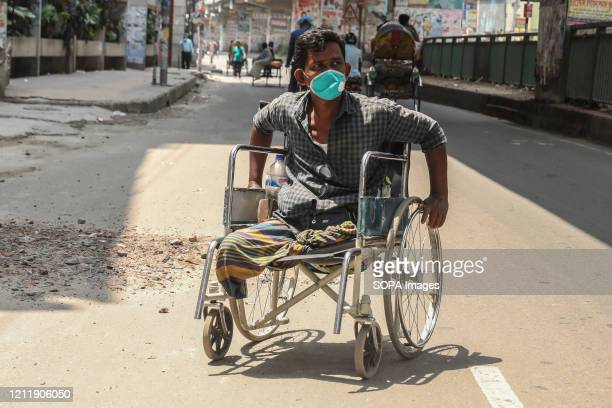Man in a wheelchair wearing a face mask as a precaution during the coronavirus crisis. India Health Ministry recorded a total of 46,476 infections...