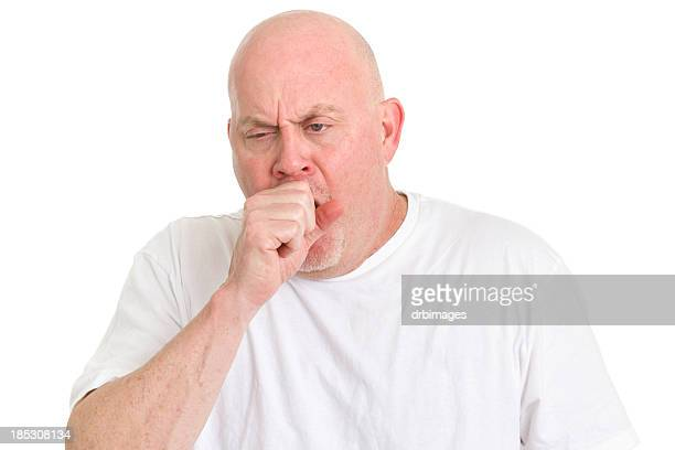 A man in a white shirt covering his mouth whist coughing