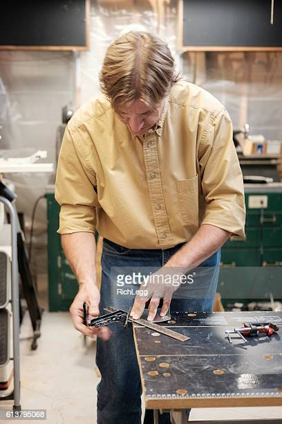 man in a workshop - rich_legg stock photos and pictures