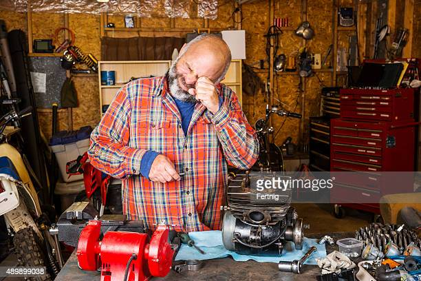 man in a workshop with an eye injury - eye injury stock pictures, royalty-free photos & images