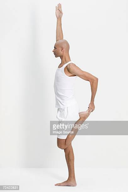 man in a yoga pose - beau pied homme photos et images de collection