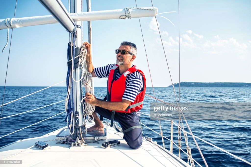 Man in action of pulling rope : Stock Photo