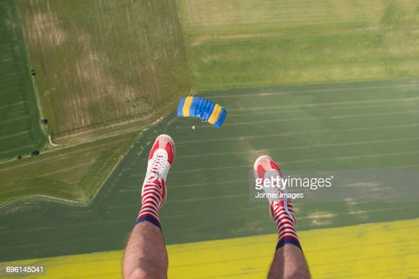 man in air, low section - rushing the field stock pictures, royalty-free photos & images