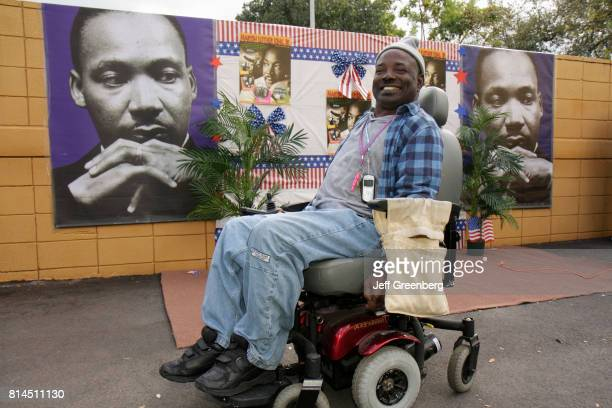 Man in an electric wheelchair at the Association for Development of Exceptional, MLK Day Carnival.
