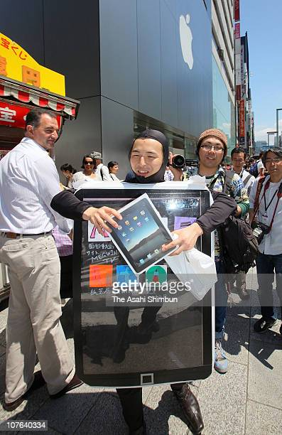 A man in an iPad costume shows Apple iPad tablet computers outside the Apple Store Ginza on the day of its Japanese launch on May 28 2010 in Tokyo...