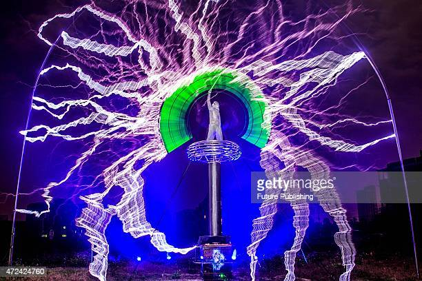A man in an iron mesh suit plays with manmade lightening during a show on April 29 2015 in Changle China Former electronics engineer Wang Zengxiang...