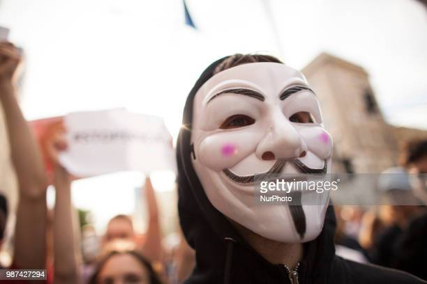 Man in Anonymous mask during protest against ACTA 20 in Warsaw in Warsaw on June 29 2018