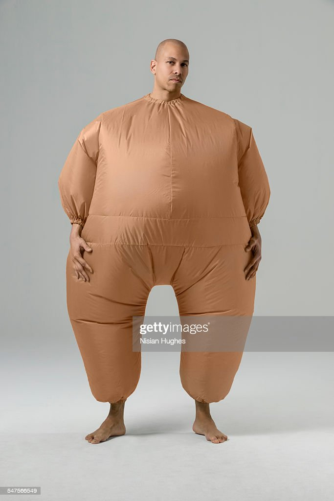Man in balloon suit looking at camera : Stock Photo