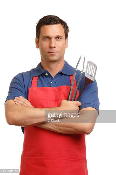 Man in Barbecue Apron with BBQ Tongs On White