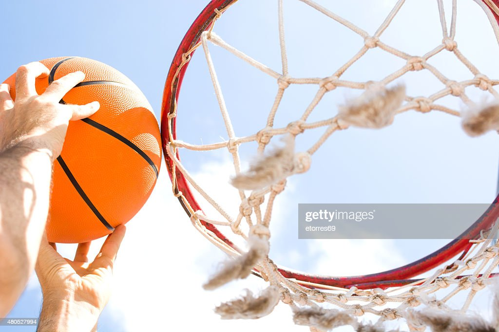 man in basketball field : Stockfoto